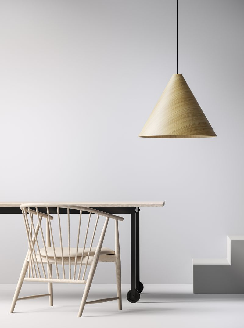 Minimalistic workspace setting with wooden lounge chairs, tables and lamps in Nordic Light