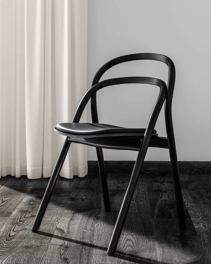 Portratin of Artistic Dark wooden office chair in Nordic Black & White