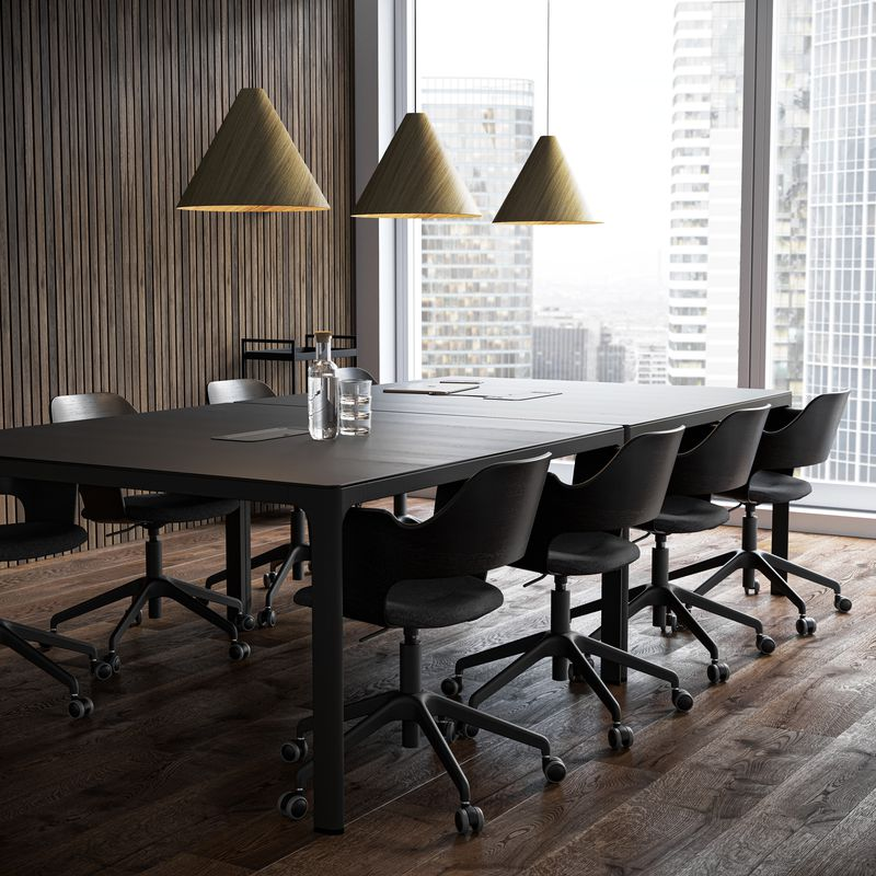Meeting room with black tables and black office chairs and wooden lamps in Nordic Dark setting