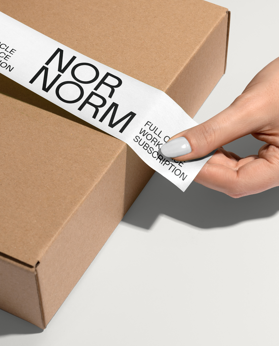 Person putting on packaging for NORNORM