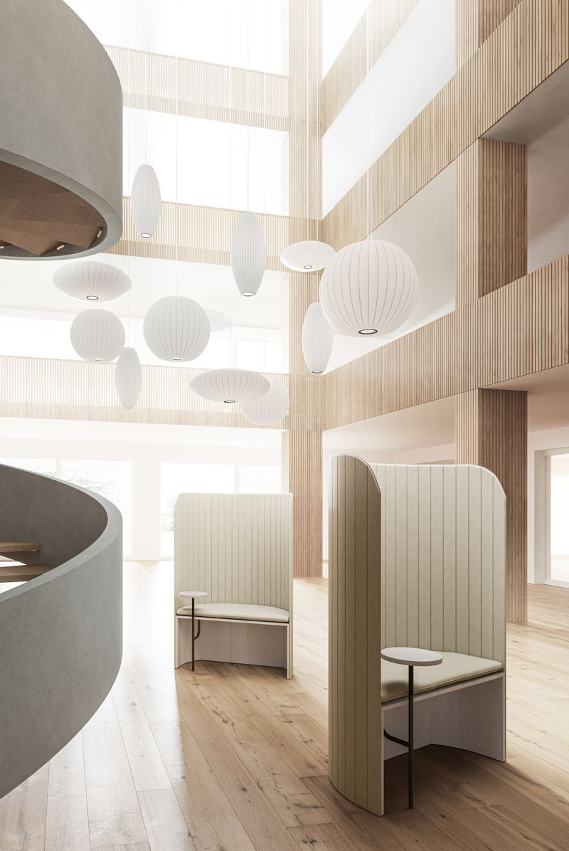 Open lounge area with wooden features and facade in Nordic Light including focus work pods featuring Zilenzio shields