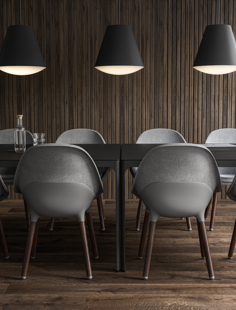 Sophisticated meeting room with dark pendant lamps and grey office chairs in the style Nordic Dark