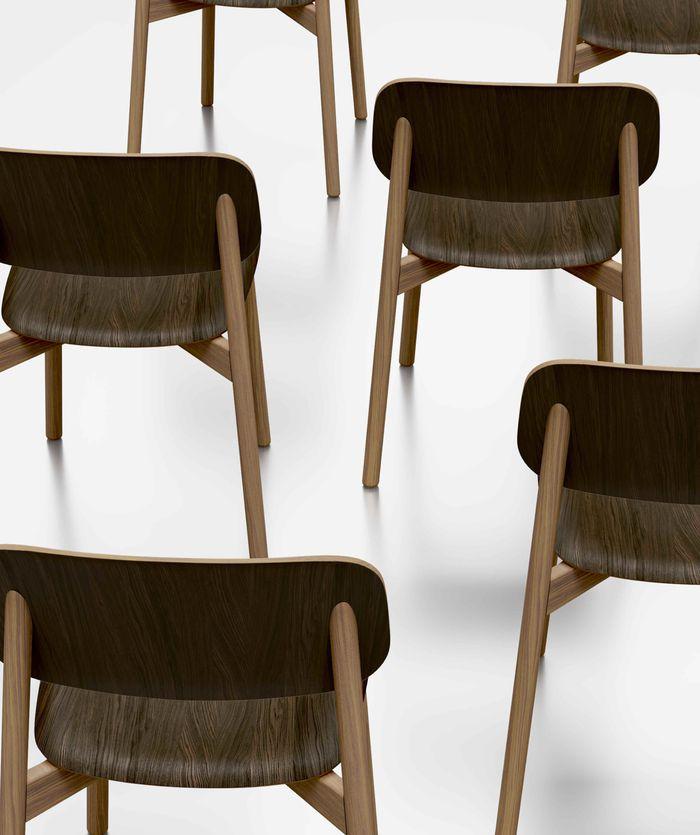 Beautiful artistic dark wooden chairs arranged in symmetry Nordic Dark