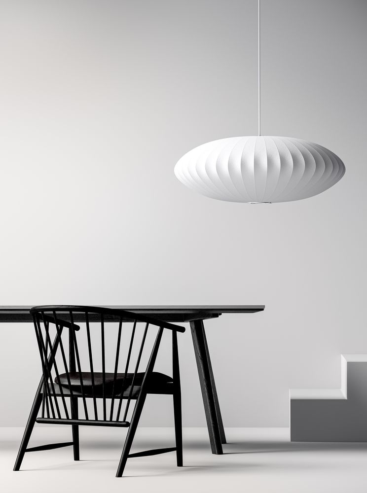 Minimalistic workspace setting with black wooden lounge chairs, work desk and white pendant lamp in Nordic Black & White