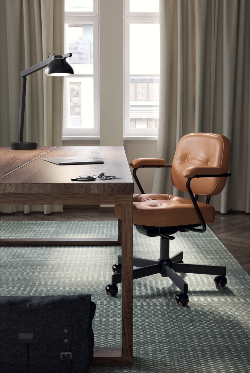 Executive office with brown leather chair, wooden desk and beige curtains in Nordic Dark