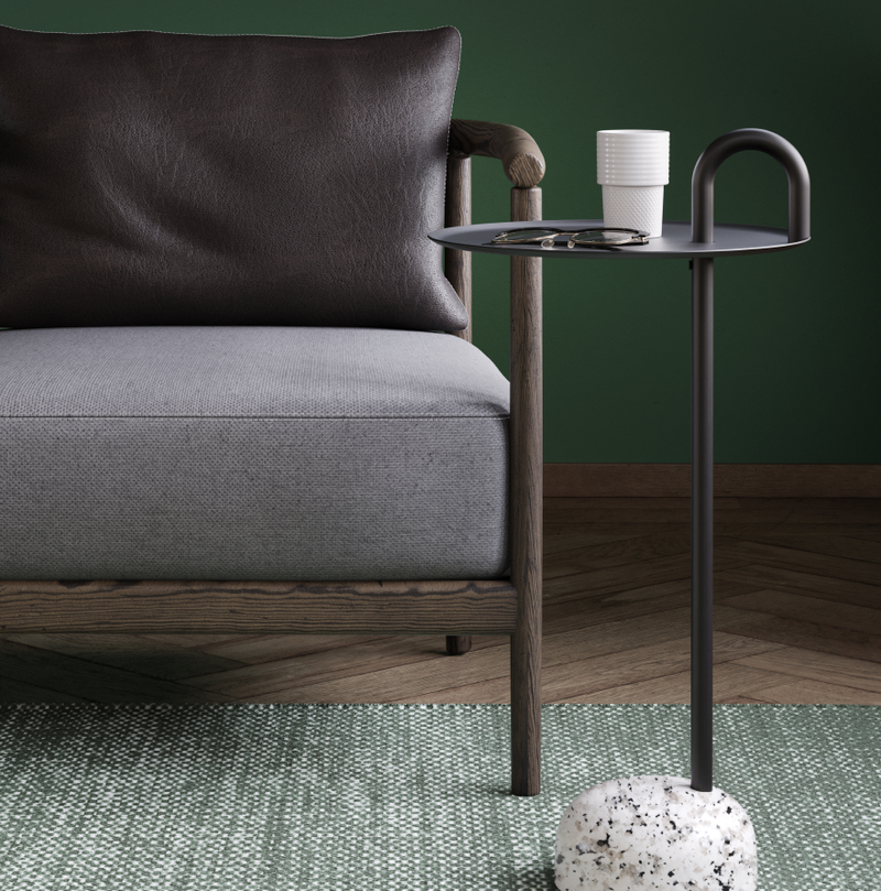 Executive office lounge area with lounge chair, green carpets and Bowler side coffee table in Nordic Dark Green