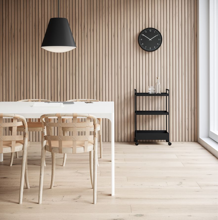 Meeting room with wooden wall panels, black pendant lamps, clock and light office chairs in Nordic Light setting