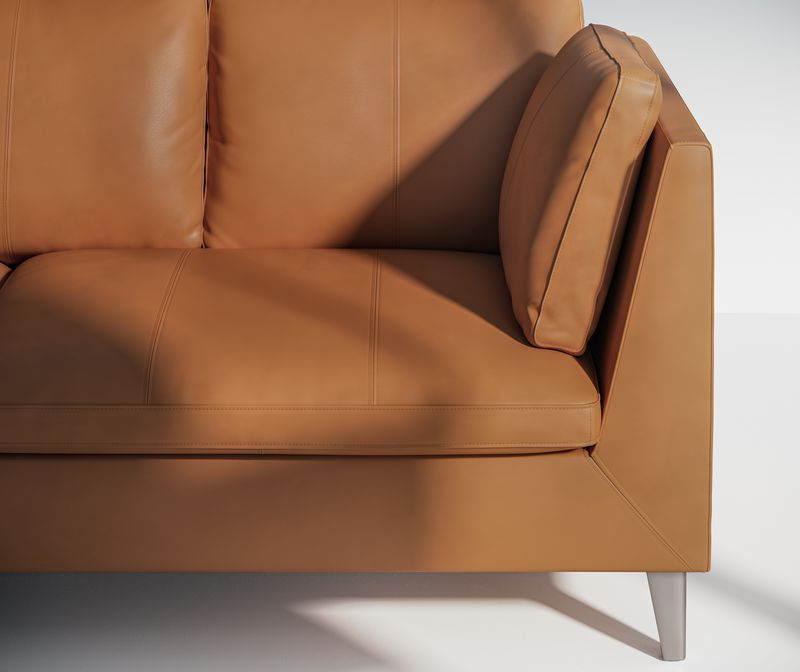 Close up of a oiled brown leather sofa in a lounge room in Nordic Light