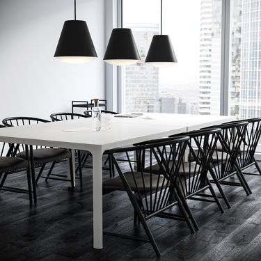 Meeting room with white tables and black wooden office chairs and black pendant lamps in Nordic Black & White setting