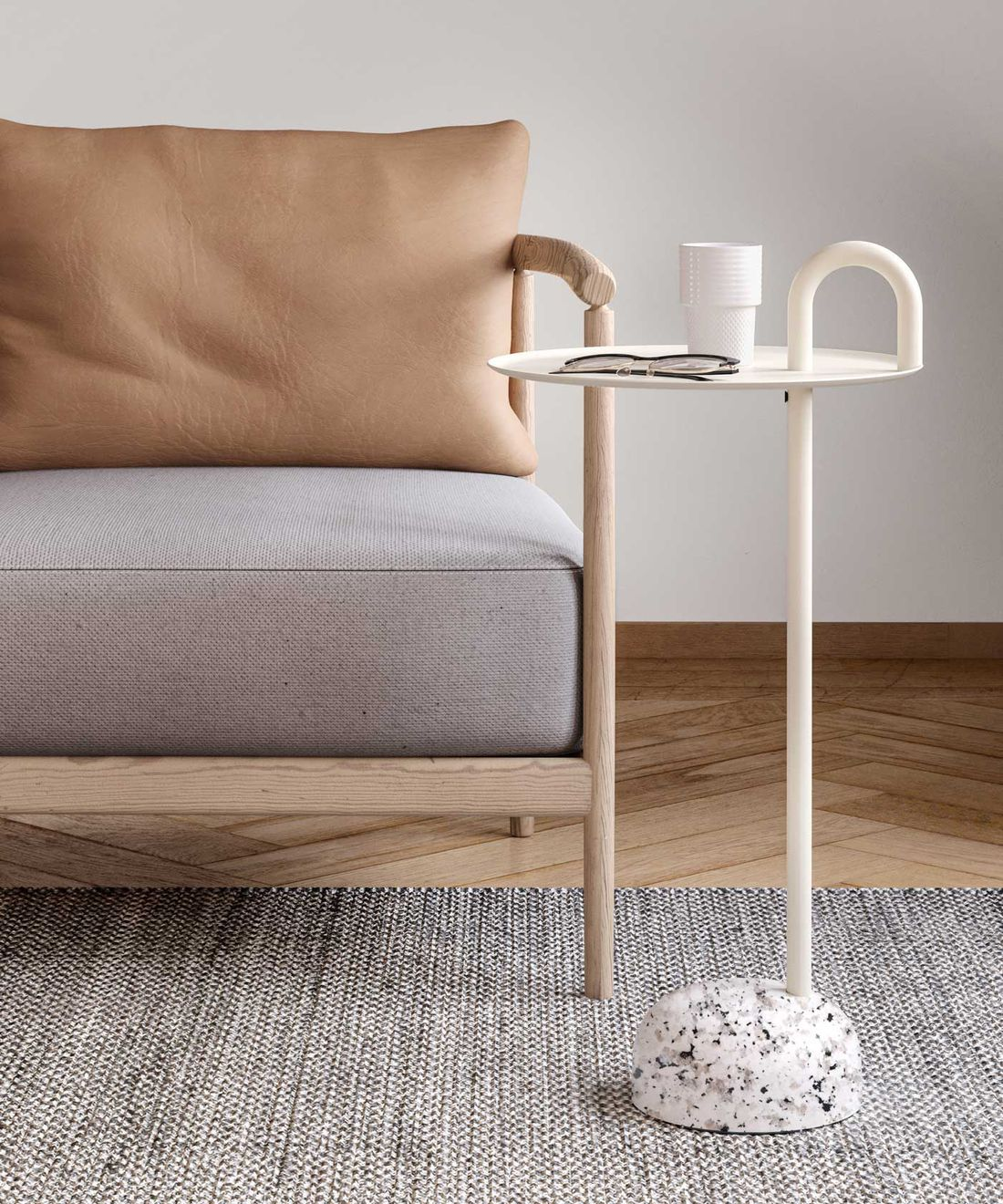 Lounge chair with comfortable cushions and a white side table in Nordic Light