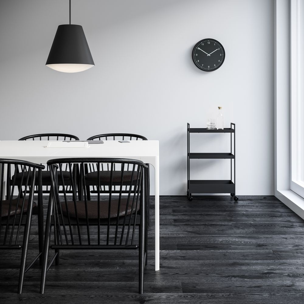 Meeting room with white table and black chairs and black pendant lamps in Nordic Black and White setting