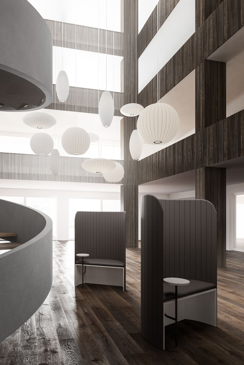 Open lounge area with dark wooden features and facade in Nordic Dark including focus work pods featuring Zilenzio shields