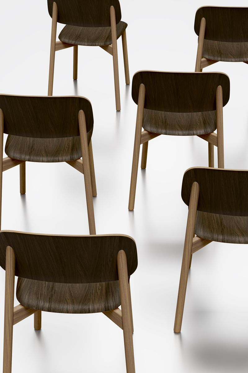 Beautiful artistic dark wooden chairs arranged in Nordic Dark