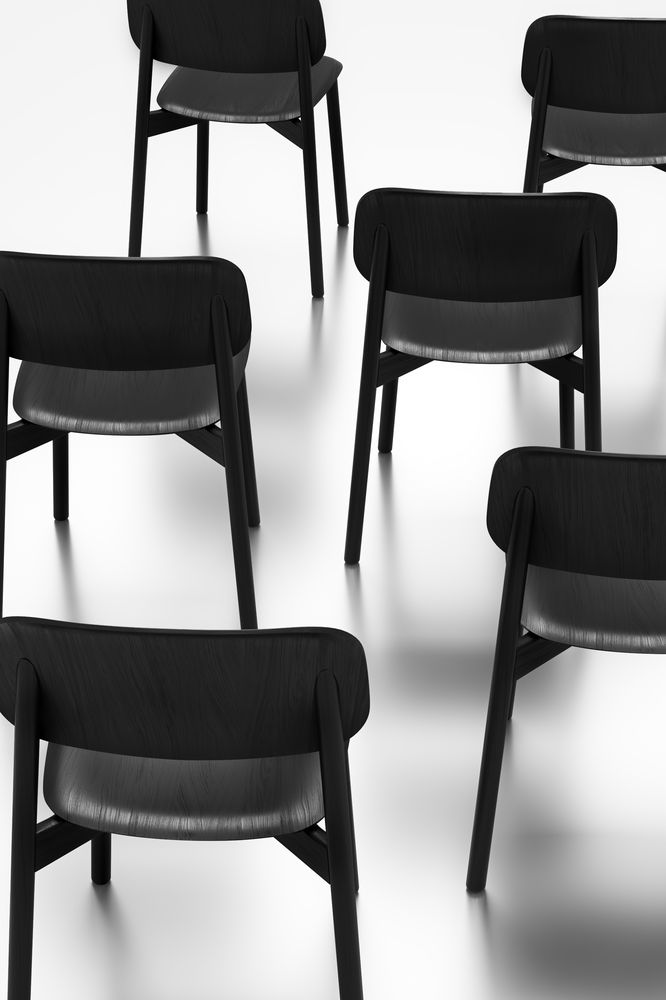 Beautiful artistic black wooden chairs arranged in Nordic Black & White