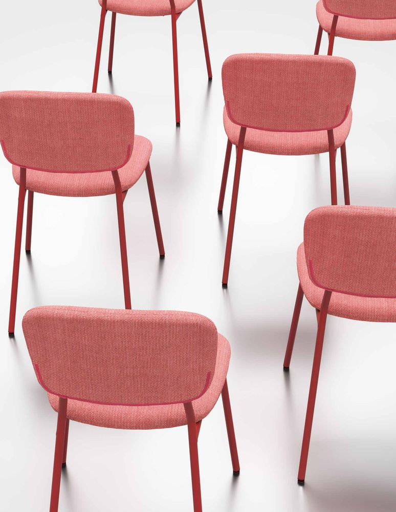 Beautiful pastel red chairs in symmetry in Nordic Light Red