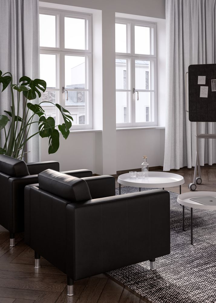 Executive office with black lounge chair and white coffee table in Nordic Black & White.jpg