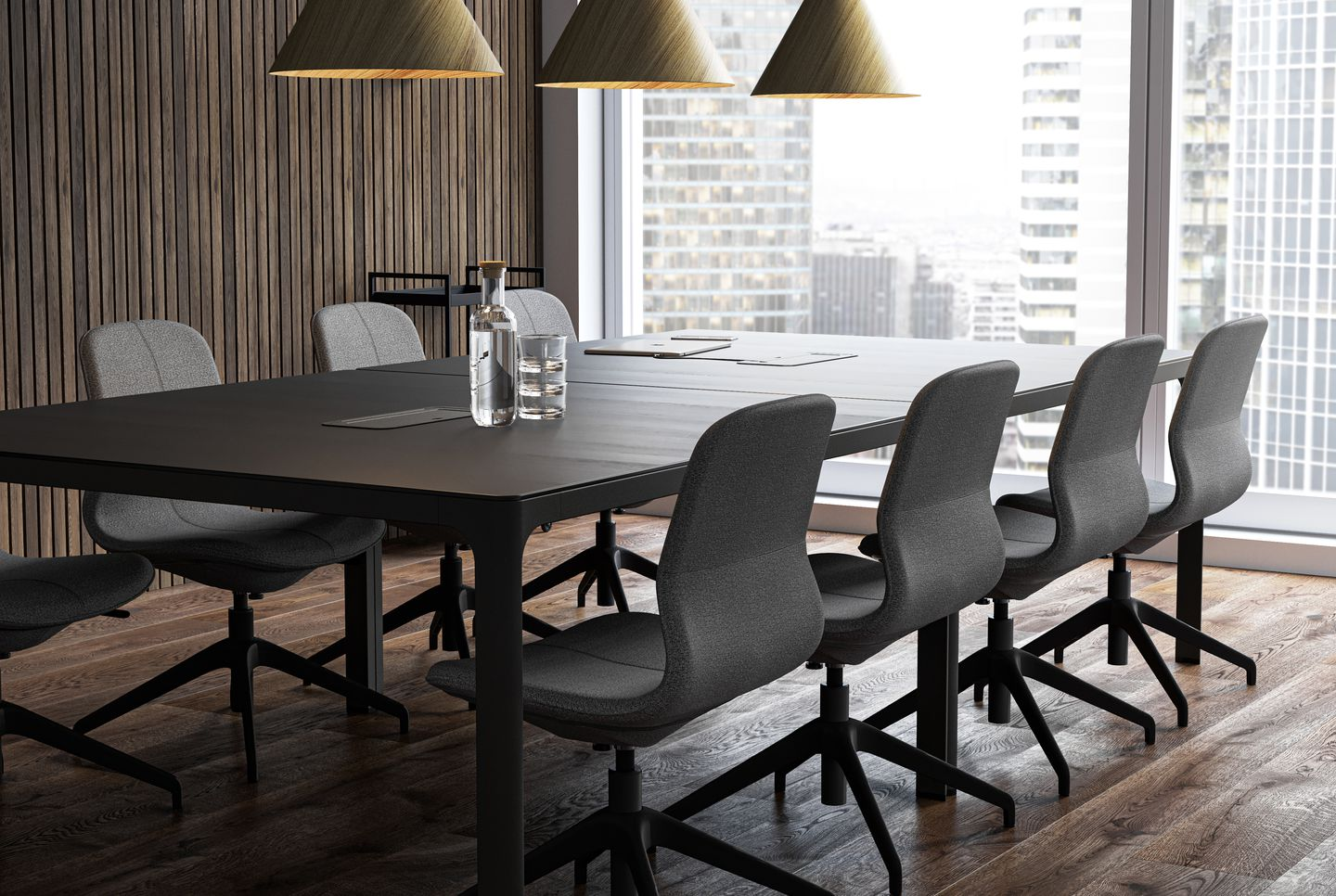 Meeting room with dark wooden panels, grey office chairs and black table. With wooden pendant lights in Nordic Dark setting