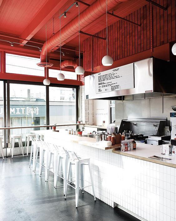 Restaurant with counter seating and red accents