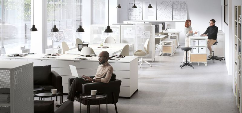 Open Office with people working and communicating
