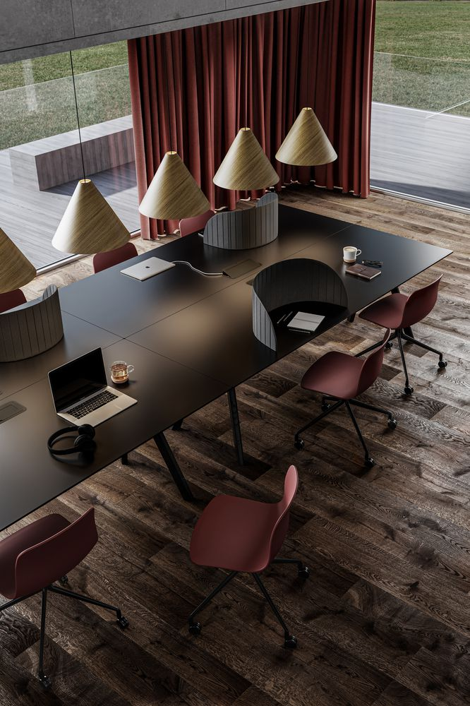 Open workspace with dark tables and red office chairs with red accents in Nordic Dark.jpg