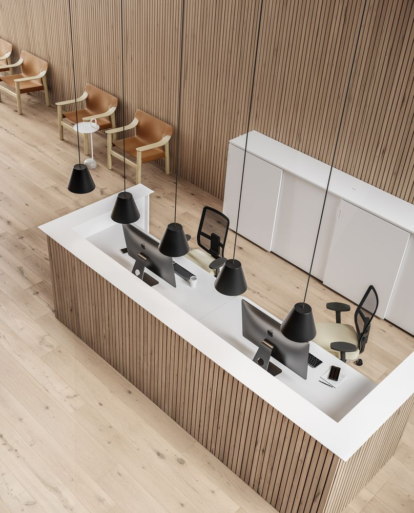Reception  with wooden details, SINKER lamps, JAMES MESH office chairs and BEKANT tables in Nordic Light