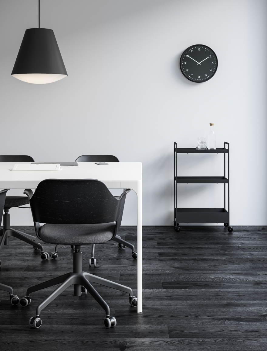 Meeting room with grey office chairs and black pendant lamps, white tables and clock in Nordic Black & White