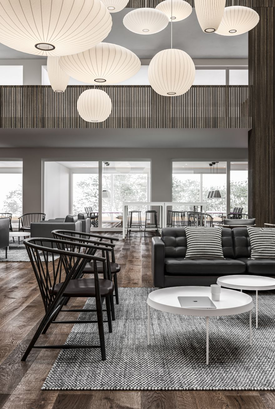 Lounge area with white coffee tables, grey sofa, black wooden lounge chair in Nordic Black & White