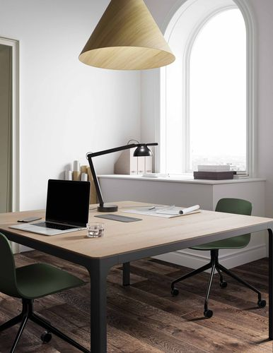 Minimal office with beautiful wooden desk, green chairs and wooden pendant lamps in Nordic Dark Green